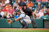 Trenton Thunder catcher Chace Numata (6) in front of home plate umpire Chris Scott during a game against the Richmond Flying Squirrels on May 11, 2018 at The Diamond in Richmond, Virginia.  Richmond defeated Trenton 6-1.  (Mike Janes/Four Seam Images)