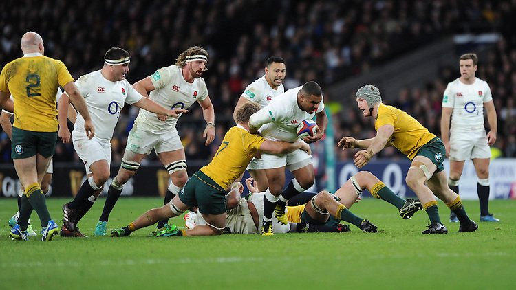 Kyle Sinckler of England is tackled by Michael Hooper of Australia as David Pocock of Australia supports during the Old Mutual Wealth Series match between England and Australia at Twickenham Stadium on Saturday 3rd December 2016 (Photo by Rob Munro)