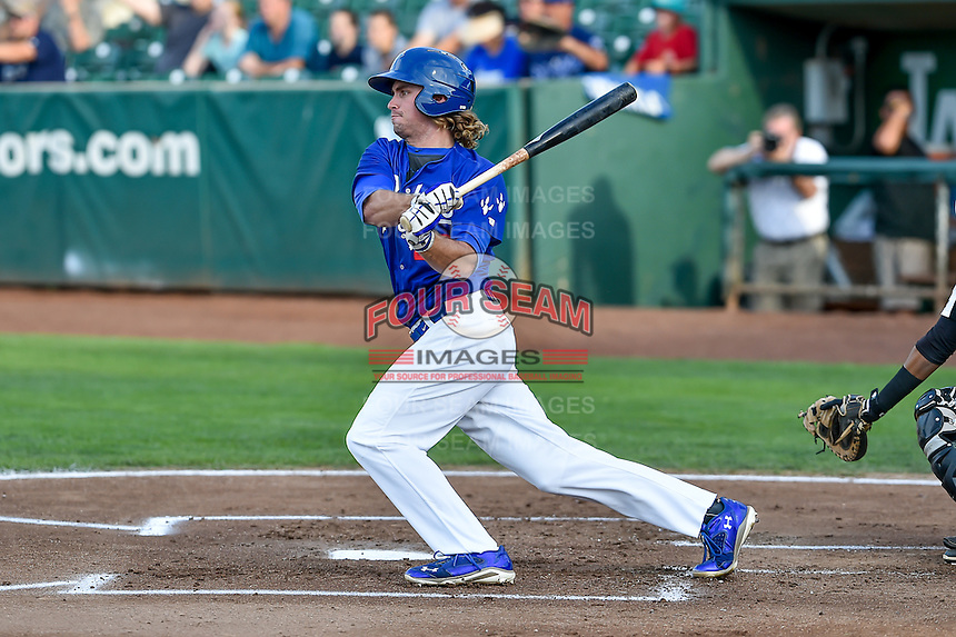 DJ Peters (27) of the Ogden Raptors follows through on his swing against the Grand Junction Rockies during the Pioneer League game at Lindquist Field on August 26, 2016 in Ogden, Utah. The Raptors defeated the Rockies 6-5. (Stephen Smith/Four Seam Images)