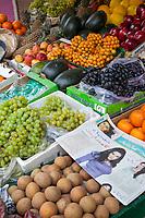 India, Dehradun.  Fruit Stand with Urdu Newspaper.