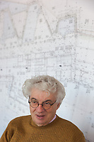 """Switzerland. Canton Ticino. Mendrisio. The architect Mario Botta in his office. On the wall, rolls of blueprints with architectural plans and technical drawings of the """"Thermalbad"""" in Baden, Switzerland. 30.10.2017 © 2017 Didier Ruef"""