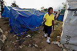 Kathia Amy, a 17-year old Haitian, walks through a homeless camp to her school early in the morning in Grand-Goave, where hundreds of families remain homeless more than a year after the January 2010 earthquake that ravaged parts of the Caribbean nation. Amy lives in a tent and attends the College Les Freres Milord, a school that was rebuilt after the quake by members of the ACT Alliance, which has also provided a variety of services to residents of a homeless camp surrounding the school.