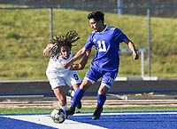 NWA Democrat-Gazette/CHARLIE KAIJO Bentonville High School Elliott Nimrod (9) and Rogers High School Felipe Rodriguez (11) fight for possession of the ball during a soccer game, Friday, April 26, 2019 at  Whitey Smith Stadium at Rogers High School in Rogers.