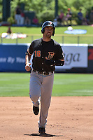 Travis Ishikawa (16) of the Fresno Grizzlies during the game against the Salt Lake Bees at Smith's Ballpark on May 26, 2014 in Salt Lake City, Utah.  (Stephen Smith/Four Seam Images)