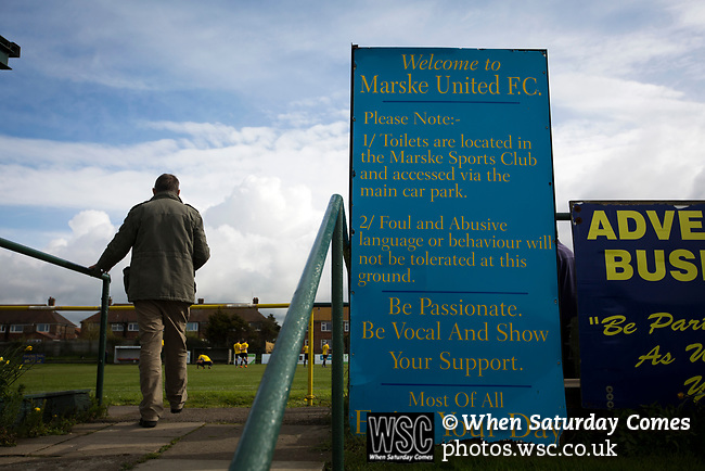 A spectator makes his way to the stand at half-time at Mount Pleasant as Marske United take on Billingham Synthonia in a Northern League division one fixture. Formed in 1956 in Marske-by-the-Sea, the home club had secured automatic promotion to the Northern Premier League two days before and were in the midst of a run of six home games in 10 days as they attempted to overtake Morpeth Town to win the league. They won this match 6-1 against already relegated Billingham, watched by a crowd of 196.