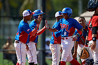 Raymond Mola (8) high fives Aniel Mendoza (1) and Jerry Alejo (7) after hitting a home run during the Dominican Prospect League Elite Florida Event at Pompano Beach Baseball Park on October 14, 2019 in Pompano beach, Florida.  (Mike Janes/Four Seam Images)