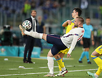 3rd July 2021, Stadio Olimpico, Rome, Italy;  Euro 2020 Football Championships, England versus Ukraine quarter final;   Luke Shaw  of England clears the ball from defense