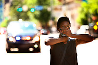 "Kathryn Penn II gestures with her hands as chants of ""I can't breathe"" ring out during a youth led march against police brutality and environmental racism in downtown where they marched from the City County Building and throughout the city on Tuesday June 16, 2020 in Pittsburgh, Pennsylvania. (Photo by Jared Wickerham/Pittsburgh City Paper)"