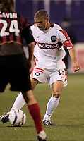 The Chicago Fire's Chris Armas is marked by the MetroStars' Eddie Gaven. The Chicago Fire played the NY/NJ MetroStars to a one all tie at Giant's Stadium, East Rutherford, NJ, on May 15, 2004.