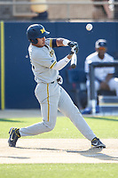 Michigan Wolverines outfielder Tito Flores (22) swings the bat during the NCAA baseball tournament against the Connecticut Huskies on June 4, 2021 at Frank Eck Stadium in Notre Dame, Indiana. The Huskies defeated the Wolverines 6-1. (Andrew Woolley/Four Seam Images)