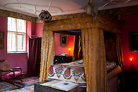 Bloody Mary's bedroom is furnished with a four-poster bed topped with feathers and the walls are a deep red, allegedly so painted as the colour would draw out measles