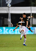 LAKE BUENA VISTA, FL - JULY 18: Eduard Atuesta #20 of LAFC clears the ball away from an opponent during a game between Los Angeles Galaxy and Los Angeles FC at ESPN Wide World of Sports on July 18, 2020 in Lake Buena Vista, Florida.