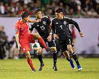 CHICAGO, IL - JULY 7: Christian Pulisic #10, Hector Moreno #15 and Raul Jimenez #9 contest the ball during a game between Mexico and USMNT at Soldiers Field on July 7, 2019 in Chicago, Illinois.
