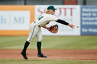 Aaron Shackelford (44) of the Greensboro Grasshoppers flips the ball towards first base during the game against the Rome Braves at First National Bank Field on May 16, 2021 in Greensboro, North Carolina. (Brian Westerholt/Four Seam Images)