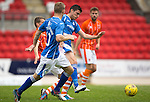 St Johnstone v Blackpool...25.07.15  McDiarmid Park, Perth.. Pre-Season Friendly<br /> Graham Cummins fends off Jim McAlister<br /> Picture by Graeme Hart.<br /> Copyright Perthshire Picture Agency<br /> Tel: 01738 623350  Mobile: 07990 594431
