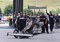 Jun 21, 2015; Bristol, TN, USA; Crew members wait with NHRA top fuel driver Tony Schumacher during the Thunder Valley Nationals at Bristol Dragway. Mandatory Credit: Mark J. Rebilas-