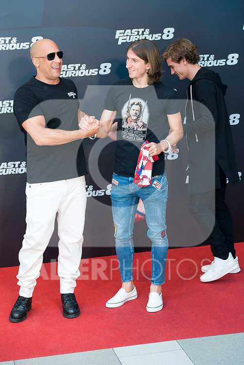 "American actor Vin Diesel with Atletico de Madrid's player Antoine Griezmann and Filipe Luis during the presentation of the film ""Fast & Furious 8"" at Hotel Villa Magna in Madrid, April 06, 2017. Spain.<br /> (ALTERPHOTOS/BorjaB.Hojas)"