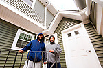 WATERBURY, CT 21_NEW_122017JS01-- Dorrell Bass and his brother Chad Bass, stand outside their new apartment on South Main Street in Waterbury on Wednesday. The family is one of the last ones to find a place to live after being displaced by the Lounsbury Street fire in May that destroyed three homes. <br />Jim Shannon Republican-American