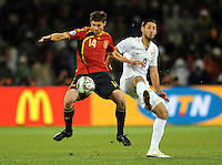 Xabi Alonso of Spain and Clint Dempsey of USA. USA defeated Spain 2-0 during the semi-finals of the FIFA Confederations Cup at Free State Stadium in Manguang/Bloemfontein, South Africa on June 24, 2009..