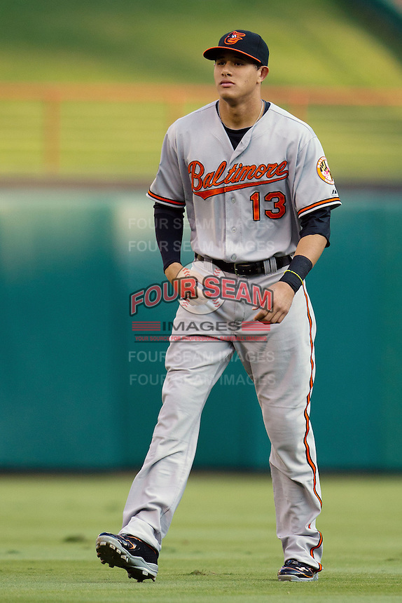 Baltimore Orioles third baseman Manny Machado #13 before during the Major League Baseball game against the Texas Rangers on August 21st, 2012 at the Rangers Ballpark in Arlington, Texas. The Orioles defeated the Rangers 5-3. (Andrew Woolley/Four Seam Images).
