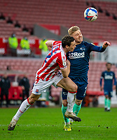 20th March 2021; Bet365 Stadium, Stoke, Staffordshire, England; English Football League Championship Football, Stoke City versus Derby County; James Chester of Stoke City and Kamil Jozwiak of Derby County challenges for the ball