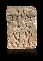 Pictures & images of the North Gate Hittite sculpture stele depicting man with wolves. 8the century BC.  Karatepe Aslantas Open-Air Museum (Karatepe-Aslantaş Açık Hava Müzesi), Osmaniye Province, Turkey. Against black background