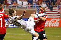 7 June 2011: USA Men's National Team defender Clarence Goodson (21) get his foot up near Canada defender Marcal De Jong (19) face during the CONCACAF soccer match between USA and Canada at Ford Field Detroit, Michigan. USA won 2-0.