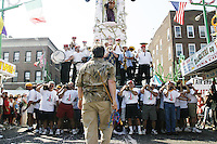 """A """"capo"""" yells out instructions to the lifters (or """"Paranza"""") at the annual Feast of Our Lady of Mount Carmel and the Dancing of the Giglio in Brooklyn, NY, on July 11, 2004."""