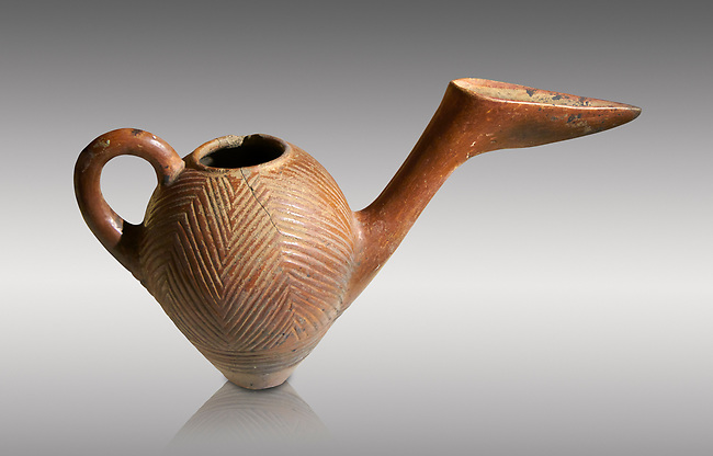 Bronze Age Anatolian terra cotta side spouted pitcher with bill shaped end - 19th to 17th century BC - Kültepe Kanesh - Museum of Anatolian Civilisations, Ankara, Turkey. Against a grey background.