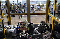 Pictured: Young families of migrants in the passenger terminal Friday 26 February 2016<br />