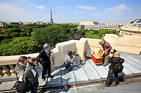 On the roof of the Grand Palais, the installation of the first hive with the president of the Grand Palais, Yves Saint-Geours and photographers from the press agencies. This installation has known an overwhelming success and, since, the Grand Palais receives each week requests from television stations from around the world to film there..