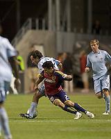 Colorado Rapids midfielder Nick LaBrocca (22) shields as Real Salt Lake defender Tony Beltran (2) pressures. Real Salt Lake tied the Colorado Rockies, 1-1, at Rio Tinto Stadium on June 6, 2009.