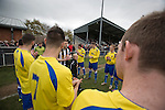 Cefn Druids AFC 1 Buckley Town 0, 12/04/2014. The Rock, Cymru Alliance league. The visiting players (in yellow) forming a guard of honour at The Rock, Rhosymedre, home to Cefn Druids AFC, prior to the club's final home game of the season against Buckley Town in the Cymru Alliance league. Druids, reputedly the oldest football club in Wales, won the Alliance league the previous week and were awarded the trophy after the Buckley Town match, which they won by 1 goal to nil, watched by a crowd of 246. The Cymru Alliance was the second tier of Welsh football based in north and mid Wales, promotion from which led directly into the Welsh Premier League. Photo by Colin McPherson.