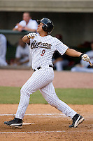 Luis Alvarez #9 of the Greeneville Astros follows through on his swing versus the Danville Braves at Pioneer Park June 28, 2009 in Greeneville, Tennessee. (Photo by Brian Westerholt / Four Seam Images)
