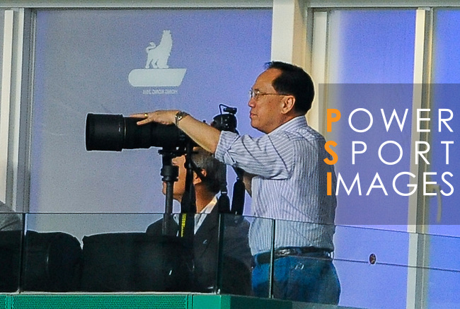 Hong Kong Chief Executive Donald Tsang takes photographs during the Asia Trophy final match against Chelsea and Aston Villa at the Hong Kong Stadium on July 30, 2011 in So Kon Po, Hong Kong. Photo by Victor Fraile / The Power of Sport Images