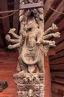 Nepal, Patan.  Carved Roof Support, Hindu Deity.