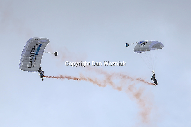 Skydivers come in for a landing during the summer X-Games at the Circuit of the Americas race track in Austin, Texas.