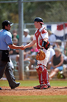 Illinois State Redbirds catcher Danny Jackson (39) shakes hands with umpire Mike Savakinas during a game against the Michigan State Spartans on March 8, 2016 at North Charlotte Regional Park in Port Charlotte, Florida.  Michigan State defeated Illinois State 15-0.  (Mike Janes/Four Seam Images)