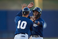 AZL Brewers Blue Orveo Saint (30) is congratulated by Danny Casals (10) after hitting a double during an Arizona League game against the AZL Brewers Gold on July 13, 2019 at American Family Fields of Phoenix in Phoenix, Arizona. The AZL Brewers Blue defeated the AZL Brewers Gold 6-0. (Zachary Lucy/Four Seam Images)