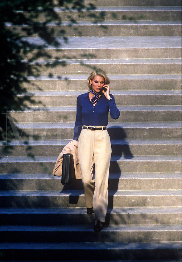 Woman talking on cell phone while walking.