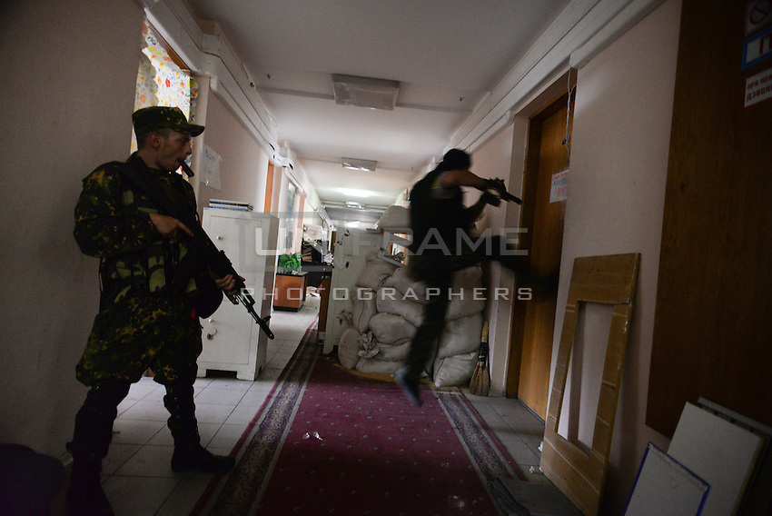 """Members of special pro-Russian battalion """"Vostok"""" seen during the military coup in DNR (Donetsk Peoples Republic), taking over town hall, held by another group of pro-russian activists. Mariupol, Ukraine. May 29, 2014"""