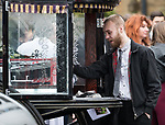 © Joel Goodman - 07973 332324 . 20/12/2017. Manchester, UK. A mourner touches his hand to Sam's coffin in the hearse , outside the church after the service . The funeral of 14-year-old Sam Berkley at Christ Church in Denton , East Manchester . Mourners wear red and white , the colours of Hattersley FC , for whom Berkley played . Amongst their number are pupils and friends from Audenshaw School . Berkley died after being hit by a grey BMW near junction 3 of the M67 in Hyde , East Manchester , on 1st December 2017 . Photo credit : Joel Goodman