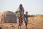Fulani woman and child in the seasonal village of Bantagiri in northern Burkina Faso.  The Fulani are traditionally nomadic pastoralists, crisscrossing the Sahel season after season in search of fresh water and green pastures for their cattle and other livestock.