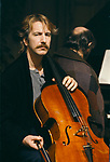 Alan Rickman British actor playing cello on film set of Truly Madly Deeply. 1991