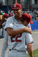 Mahoning Valley Scrappers relief pitcher Kerry Doane (22) is hugged by teammate Rafael Homblert (43) after completing a no-hitter against the Batavia Muckdogs on September 1, 2013 at Dwyer Stadium in Batavia, New York.  Doane went one inning striking out two as the Scrappers pitching duo of Luis Gomez, Carlos Melo, and Doane tossed a no-hitter 6-0 victory over Batavia.  (Mike Janes/Four Seam Images)