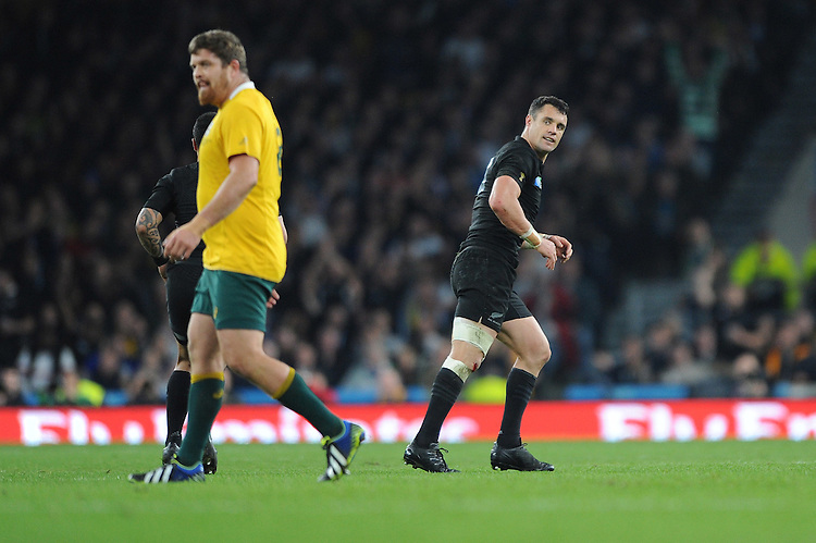Dan Carter of New Zealand turns away confidently as his drop goal goes between the posts during the Rugby World Cup Final between New Zealand and Australia - 31/10/2015 - Twickenham Stadium, London<br /> Mandatory Credit: Rob Munro/Stewart Communications