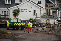 Friday 03 January 2014<br /> Pictured: Council Workers Clear the Road at Wisemans Bridge, Pembrokeshire<br /> Re: Storm force winds and some of the highest tides in decades hit Wales early on Friday.