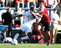 Darlington Naqbe #6 of the University of Akron is brought down by Josh Lipka #13 of the University of Louisville during the 2010 College Cup final at Harder Stadium, on December 12 2010, in Santa Barbara, California.Akron champions, 1-0.