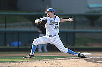 Grant Watson #12 of the UCLA Bruins pitches against the Cal Poly Mustangs at Jackie Robinson Stadium on February 22, 2014 in Los Angeles, California. Cal Poly defeated UCLA, 8-0. (Larry Goren/Four Seam Images)