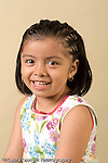 closeup headshot portrait of girl age 4 or 5 vertical